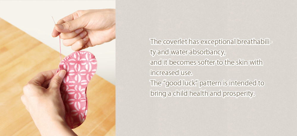 """The coverlet has exceptional breathability and water absorbancy, and it becomes softer to the skin with increased use. The """"good luck"""" pattern is intended to bring a child health and prosperity."""